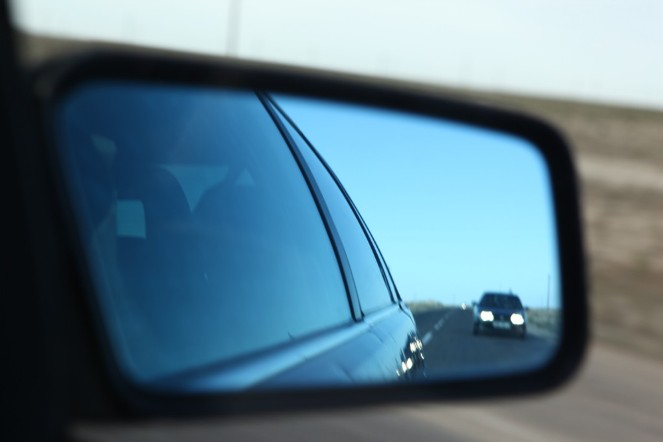 The Open Dialog Foundation: cars reflected in the mirror are officers tracking the movements of the trial observers.