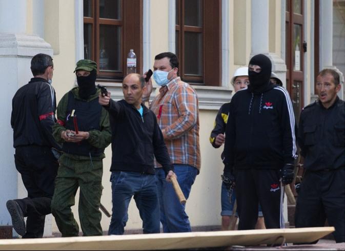 One of the provocateurs shoots on pro-Ukrainian activists